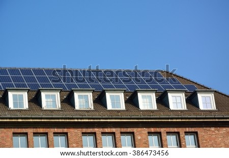 Ecological and renewable solar energy panels on the roof of a house
