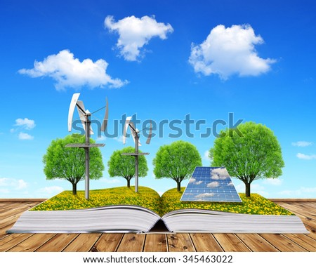 Ecological book with solar panel and wind turbines. Clean energy concept. - stock photo