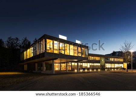 ecological energy saving wooden office building at night - stock photo