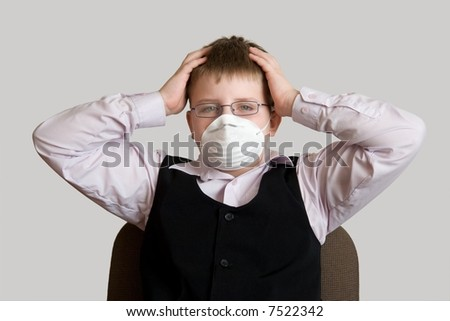 Ecological threat. The little boy in a respirator. - stock photo