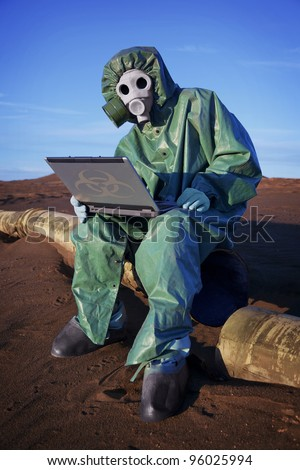 Ecologist scientist in ecological disaster zone with laptop - stock photo
