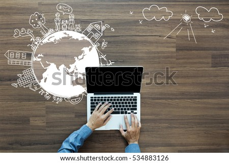 Ecology concept, Creative drawing on world map environment with happy family stories concept idea, With businessman working on laptop computer PC on wood table, view from above