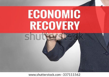 Economic Recovery word Business man touching on red tab virtual screen for business concept - stock photo