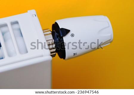 Economical thermostat setting - stock photo
