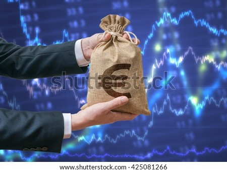 Economics of Eurozone. Businessman holds bag with money with Euro sign. Stock exchange and investment concept. - stock photo