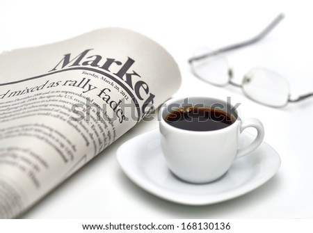 Economy newspaper with cup of coffee on white background in shallow depth of field - stock photo