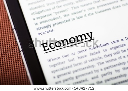 Economy on tablet pc screen, ebook concept