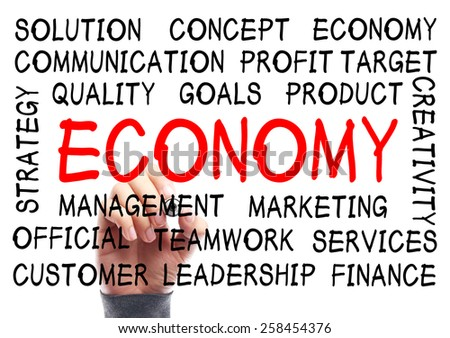 Economy word cloud is written on transparent whiteboard by the hand of a businessman. - stock photo