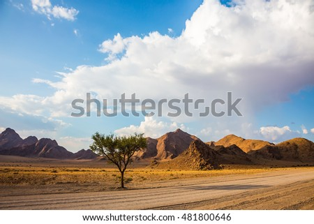 Ecotourism in Africa. Travel to Namibia, April. The wide dirt road in the Namib-Naukluft National Park