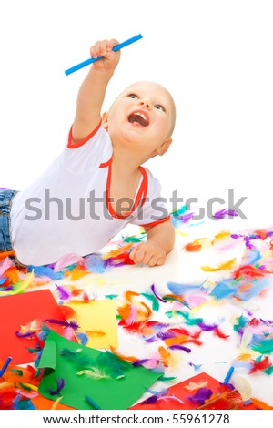 Ecstatic baby boy with color pencils and papers point at top - stock photo