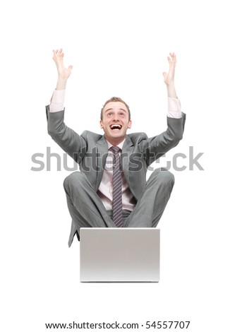 Ecstatic business man at his laptop - stock photo