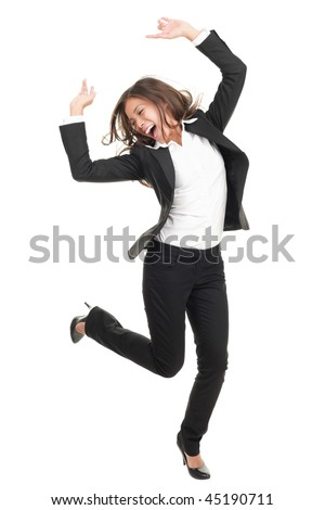 Ecstatic businesswoman in suit dancing. Excited happy asian business woman isolated in full length on white background. Mixed caucasian / chinese model. - stock photo