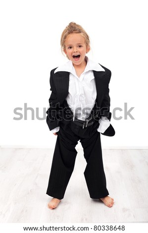 Ecstatic future businesswoman - little girl trying her mother's clothes