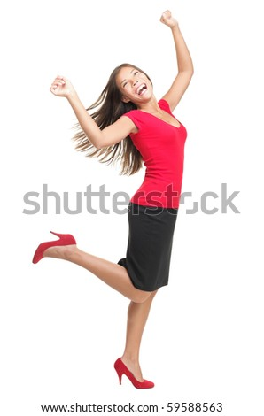 Ecstatic woman dancing and celebrating. Excited happy and joyful asian businesswoman isolated in full length on white background. Casual mixed caucasian / chinese female model in red. - stock photo