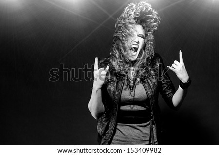 ecstatic woman is dancing to the rock music - stock photo