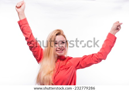 Ecstatic young woman holding up a page of paper or certificate as she punches the air with her fist in jubilation - stock photo