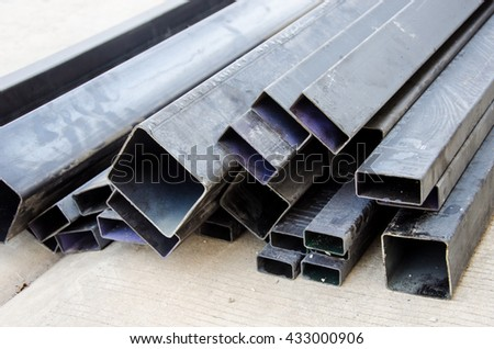 ectangular welded steel pipes on work - stock photo