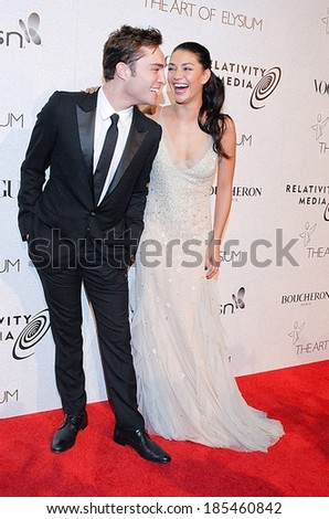 Ed Westwick, Jessica Szohr, wearing a Kevan Hall gown, at The Art of Elysium's Annual HEAVEN Gala, 9900 Wilshire Blvd, Beverly Hills, CA January 16, 2010 - stock photo