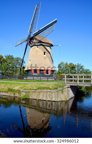 EDAM NETHERLAND OCTOBER 01 2015: Windmill in Edam is a city in the northwest Netherlands, in the province of North Holland. Combined with Volendam, Edam forms the municipality of Edam Volendam.  - stock photo
