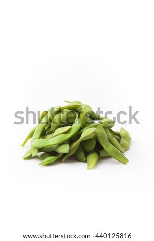 Edamame nibbles, boiled green soy beans, japanese food isolated on white - stock photo
