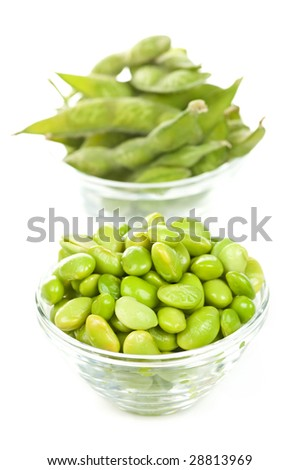 Edamame soy beans shelled and with pods in bowls - stock photo