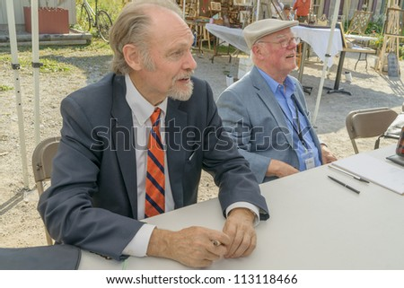 EDEN MILLS, ON - SEPTEMBER 16:  Canadian writers, Alistair MacLeod and Alistair MacLeod, sign their books at the annual Writers Festival in Eden Mills, Ontario on September 16, 2012. - stock photo