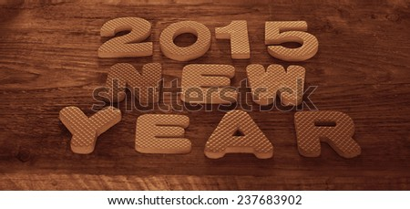 Edged space Backdrop od Closeup old retro vintage style wooden texture word of letter text New year 2015. Happy holiday christmass Background - stock photo