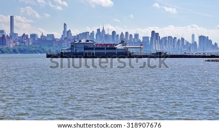 EDGEWATER, NJ -19 SEPTEMBER 2015- Scenic view of the New York Manhattan skyline seen from across the Hudson River in Edgewater, New Jersey.