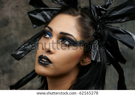 edgy gothic dramatic Halloween makeup of young woman of East Indian Ancestry