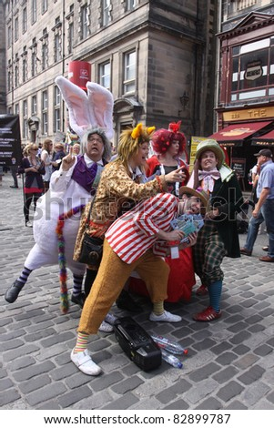 EDINBURGH- AUGUST 14: Members of TaleGate Theatre publicize their show Alice's Adventures in Wonderland during Edinburgh Fringe Festival on August 14, 2011 in Edinburgh