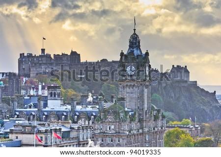 Edinburgh Castle and Balmoral Clock Tower at Dusk, Scotland - stock photo