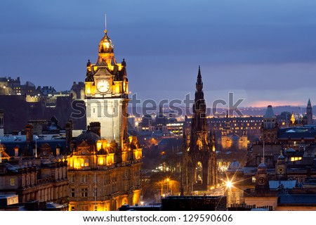 Edinburgh Clock Tower and scott monument from Calton Hill at dusk Scotland UK - stock photo