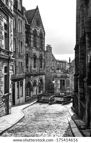 Edinburgh cobbled street in black and white - stock photo