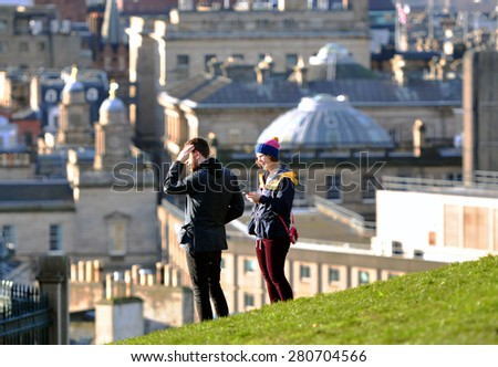 EDINBURGH - DEC 31: Tourists at the old hill over Edinburgh on December 31. 2013 in Scotland - stock photo