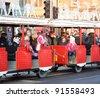 "EDINBURGH - DECEMBER 17: a ""Santa Train"" on December 17, 2011 on Princes Street in Edinburgh, UK. The Santa Train is part of Edinburgh's annual ""Winter Wonderland"" festivities. - stock photo"