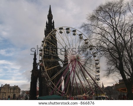 edinburgh ferris wheel wide and monument - stock photo