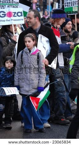 EDINBURGH - JANUARY 10: A girl participates in the anti-Israel rally January 10th, 2009 in Edinburgh, Scotland. - stock photo