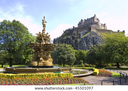 Edinburgh park fountain and castle - stock photo