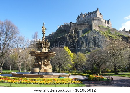 Edinburgh - Ross Fountain, Princess Street Gardens, with Edinburgh Castle in the background. - stock photo