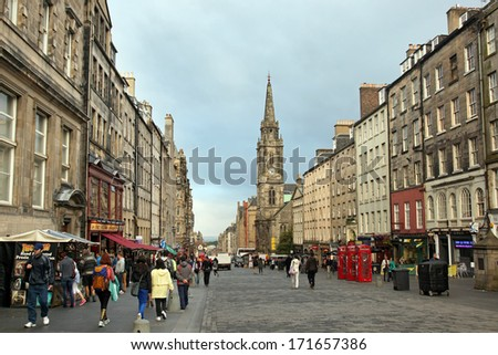 EDINBURGH, SCOTLAND - AUGUST 30: People on the Royal Mile main thoroughfare on August 30 2013 in Edinburgh Scotland.The Royal Mile runs downhill between Edinburgh Castle and Holyrood Palace. - stock photo