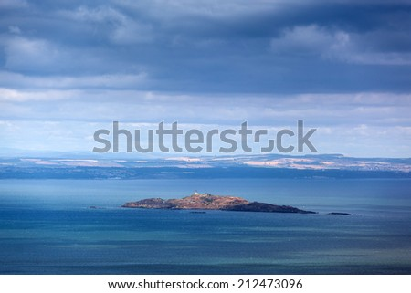 EDINBURGH, SCOTLAND: AUGUST 4, 2014: View on small island from Arthur's seat, popular destination for hiking and enjoying nature.  - stock photo