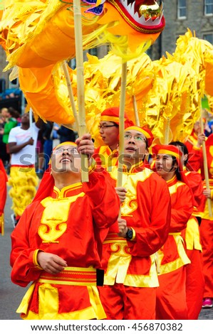 EDINBURGH, SCOTLAND - JULY 17, 2016: Closeup of Chinese performers in the Carnival of The Edinburgh Jazz and Blues Festival travelling down the Mound towards Princes Street