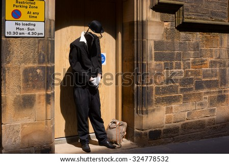 EDINBURGH, SCOTLAND - JUNE 12, 2015: Living statue street artist dressed as invisible man performing in the Old Town of Edinburgh in Scotland