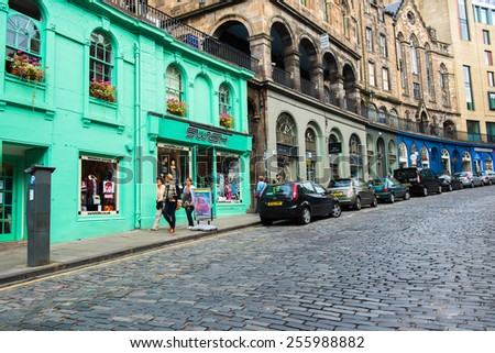 EDINBURGH,SCOTLAND-SEP 28, 2014: Victoria Street in Old Town Edinburgh. In the early 1800s it was the only passage for those wishing to access the Castle from the west. Edinburgh,UK,September 28, 2014 - stock photo