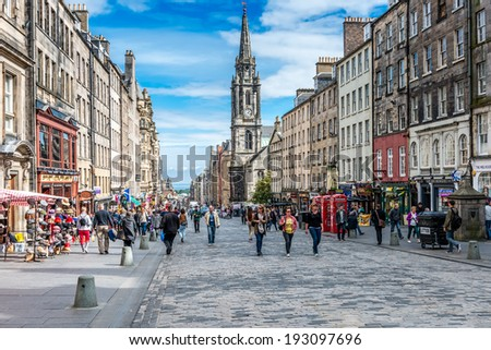EDINBURGH, SCOTLAND - SEPTEMBER 09, 2013: Edinburgh's busy Royal Mile (The Highstreet) is one of the most iconic streets in Scotland and a mayor tourist attraction