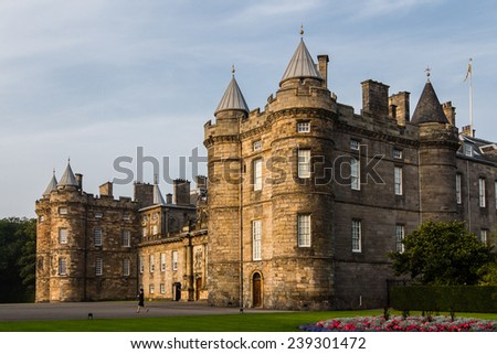 Edinburgh, Scotland - September 13, 2014: Palace of Holyroodhouse in Edinburgh, Scotland. The sunset light gives a warm touch to the setting. This palace is the Queen's official residence in Scotland. - stock photo