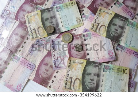 EDINBURGH, SCOTLAND, UK - CIRCA AUGUST 2015: Scottish sterling pound banknotes and coins, currency of Scotland - stock photo