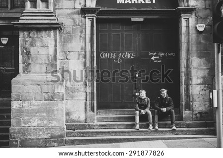EDINBURGH, SCOTLAND / UNITED KINGDOM - MAY 24 2015 - Two Unidentified young Scottish musicians hanging out before a street concert. - stock photo