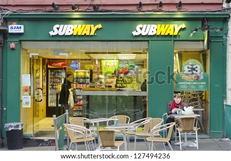 EDINBURGH - SEPTEMBER 22: A Subway fast food outlet on September 22, 2012 in Edinburgh, Scotland. Subway is the world's largest single restaurant chain with 38,181 restaurants. - stock photo