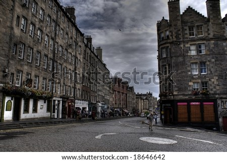 Edinburgh streets with dramatic sky tourists holiday in Scotland